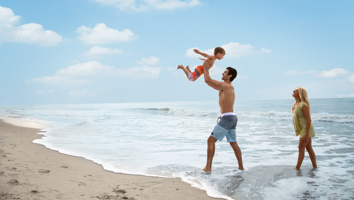Father holding up son in Myrtle Beach